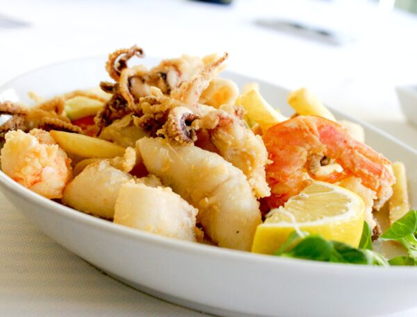 Deep Fried Shrimp and Squid With Slice of Lemon on Ceramic Plate